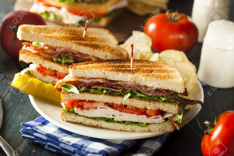 Turkey-and-Bacon-Club-Sandwich-with-Lettuce-and-Tomato-Stock-Photo